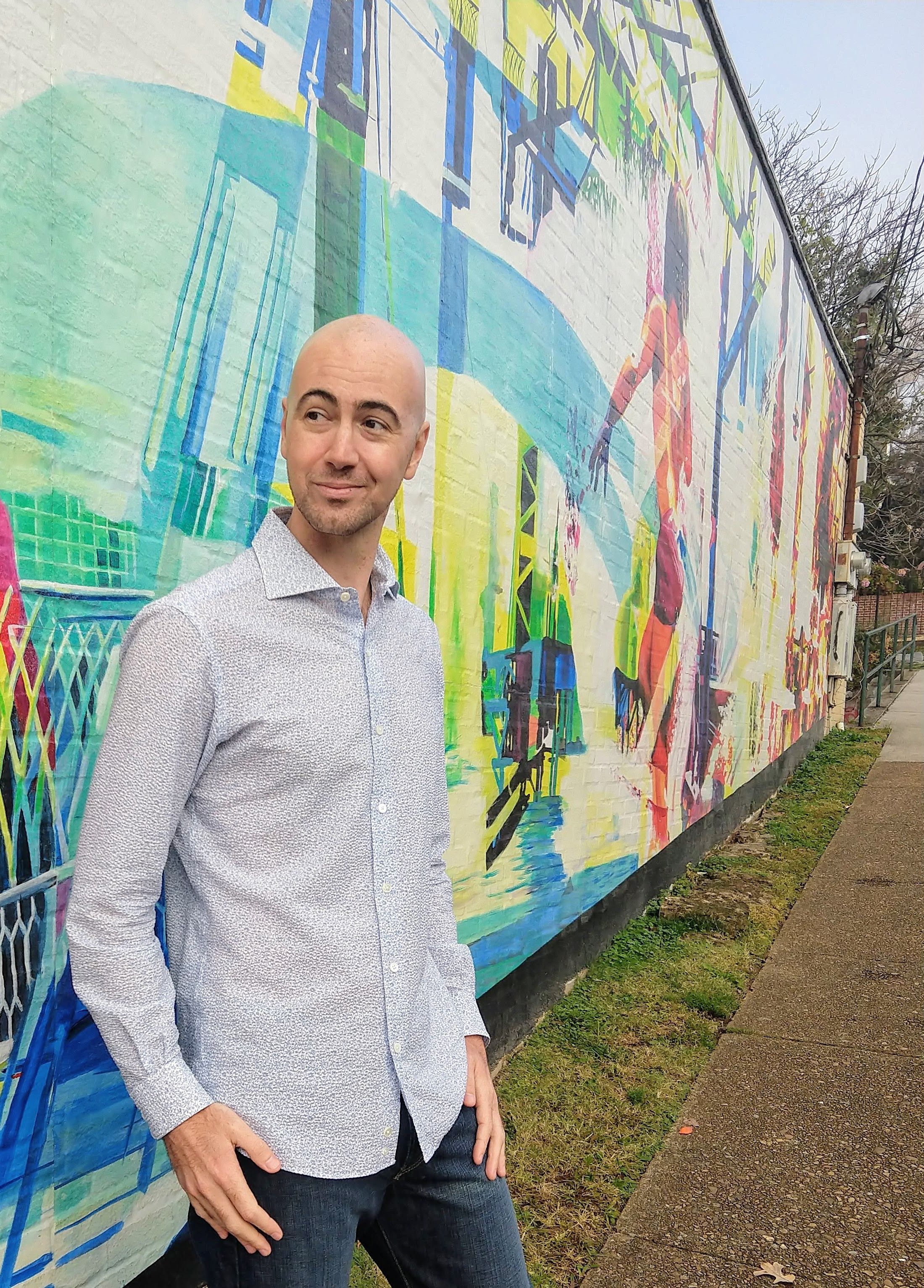 Tim Woodbury standing in front of a bright, colorful mural in beautiful Chattanooga, Tennessee
